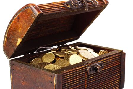 Chest with coins (Ukraine) isolated on white photo