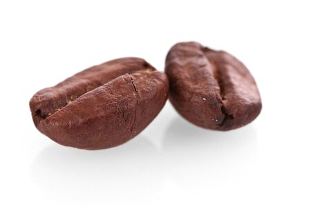 Two coffee beans closeup isolated on white Stock Photo - 9550115