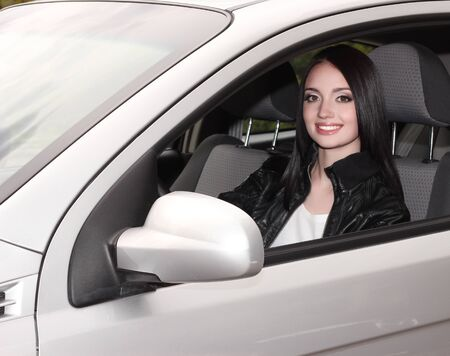young brunette woman with keys to new car photo