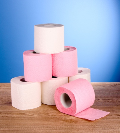 Toilet pape on blue background photo