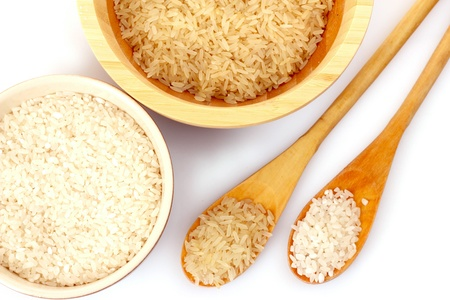 Two kinds of rice in spoons photo