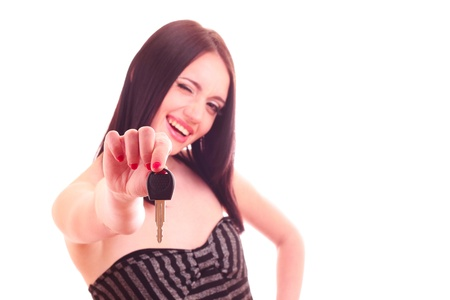 young woman with keys to new car isolated on white photo