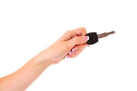Woman hand with keys isolated on white photo
