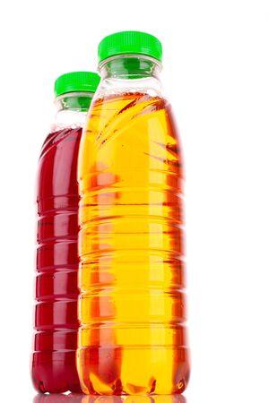 Bottles with juice isolated on white photo