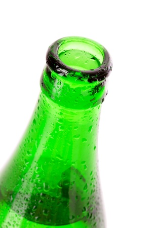 Macro shot of beer bottle with water drops isolated on white photo