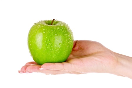 hand water: Green apple on hand isolated on white
