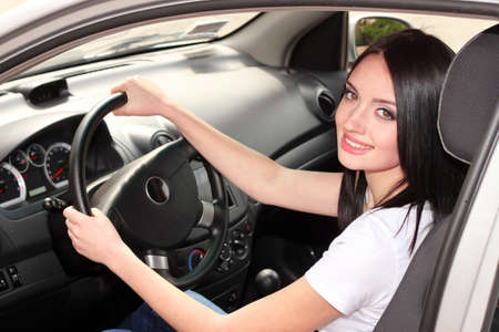 young brunette woman in new car photo