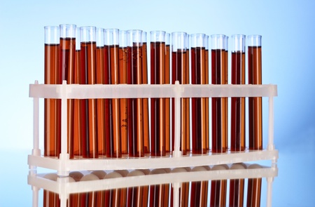 Test tubes closeup on blue background Stock Photo - 9621250