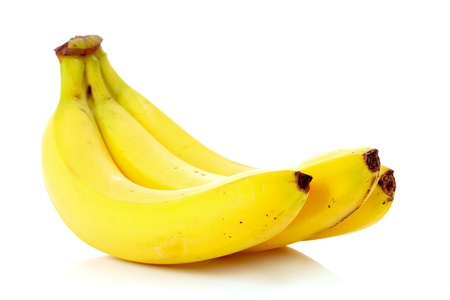 白で隔離されるバナナの束
