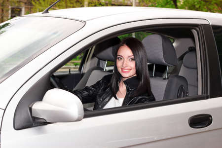 young brunette woman in new car Stock Photo - 9784556