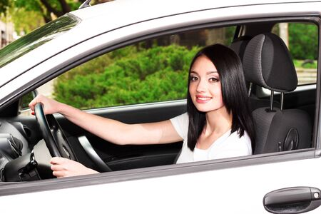 young brunette woman in new car Stock Photo - 9784555