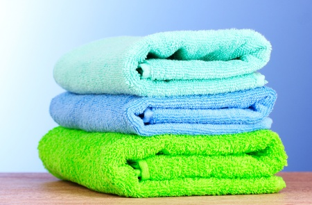 Towels on blue background photo