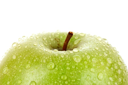 Green apple with water drops isolated on white photo