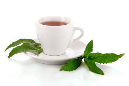 herbal remedy: Cup  with mint isolated on white