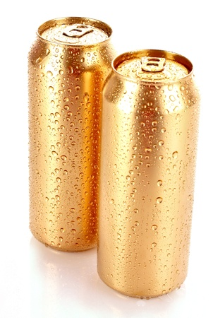 Closeup of metallic aluminum cans with water drops isolated on white photo