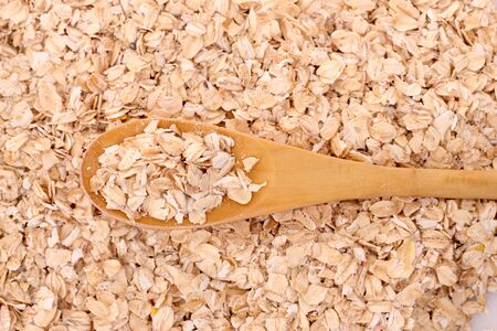 oatmeal and wooden spoon photo