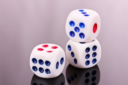 Dices on gray background photo