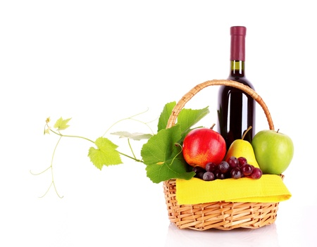 Wine and fruits isolated on white photo