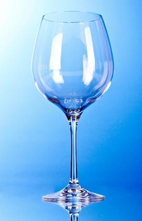 empty wine glasses on blue background photo