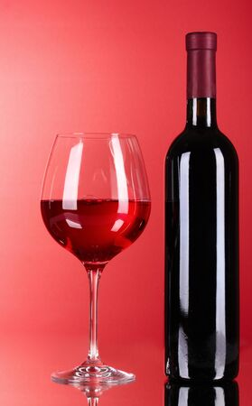Wine bottle and glass on red background Stock Photo - 9715055