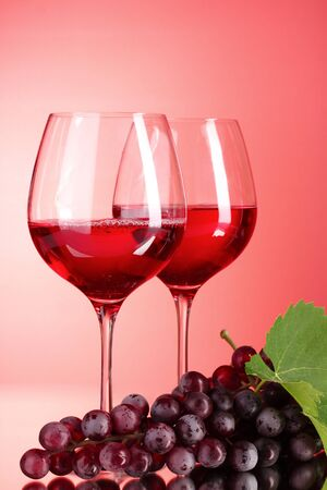 Wine bottle and glass on red background Stock Photo