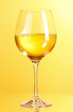 wine glass on yellow background Stock Photo - 9714954