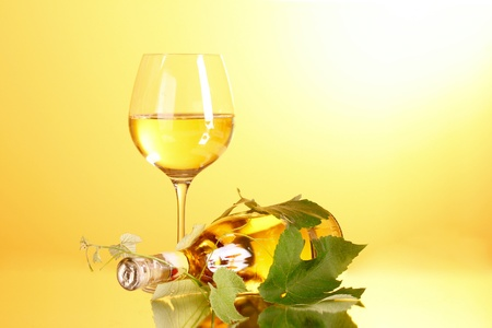 Wine glass and bottle on yellow background Stock Photo - 9714971