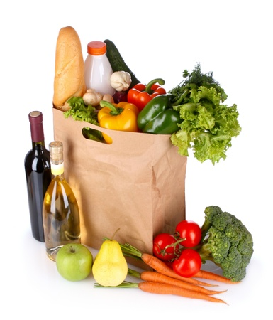 vegetables and wine in a paper bag isolated on white photo