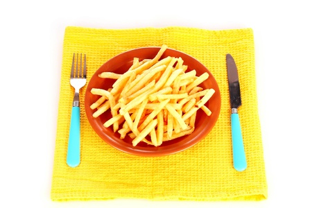 pomme: French fries on a plate and cutlery isolated on white Stock Photo