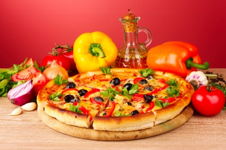 pepperoni: pizza and vegetables on a red background