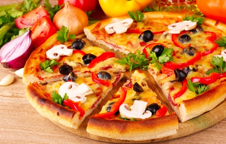 pizza dough: pizza and vegetables on wooden background