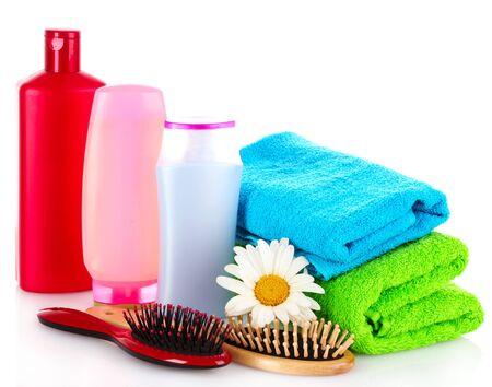 trashy: Shampoo bottles and hair brush on white Stock Photo