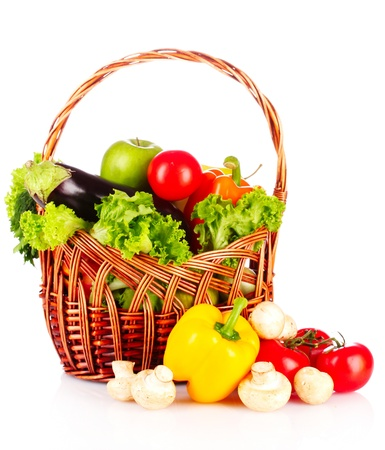 vegetables in a basket isolated on white Stock Photo - 9785167