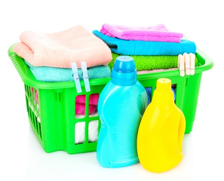 Detergents and towels in basket isolated on white Stock Photo - 9902266