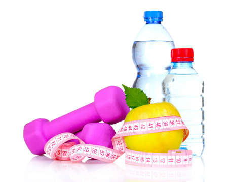 dumbbells, an apple and a bottle of water isolated on white photo