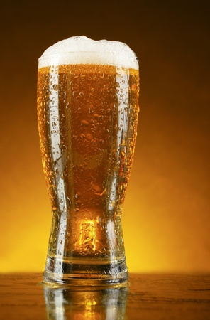 Glass of beer on dark background Stock Photo - 9902711