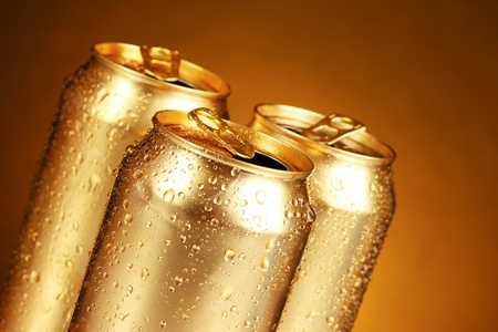 inhibited: golden tin cans on yellow background