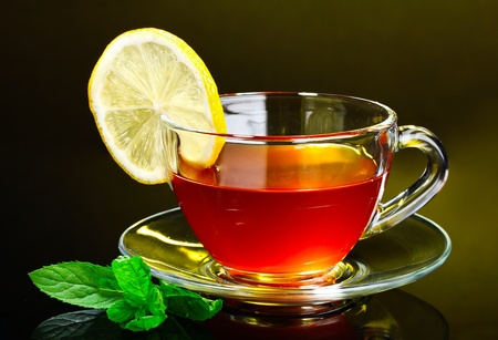 nice cup of tea and mint on yellow background
