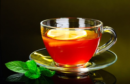 nice cup of tea and mint on yellow background photo