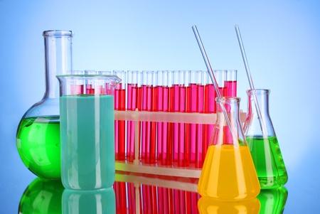 Laboratory glassware on blue background photo
