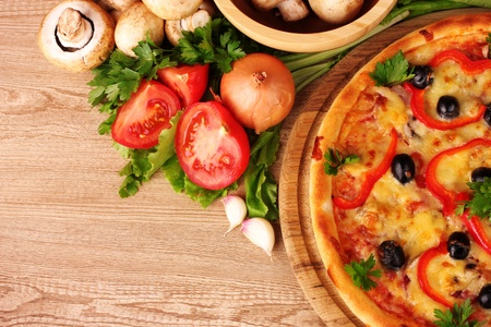 yummy: pizza and vegetables on a red background