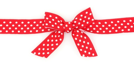 Dotted red ribbon and bow isolated on white background photo