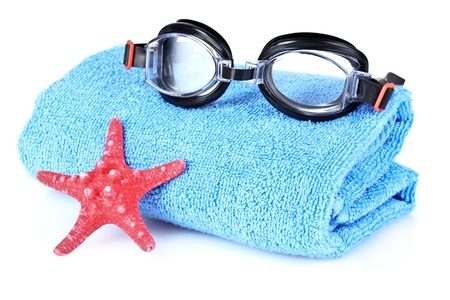 swimming goggles: glasses for swimming and towel isolated on white