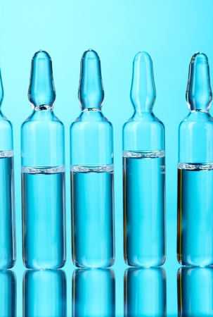 medical ampoules on blue background photo