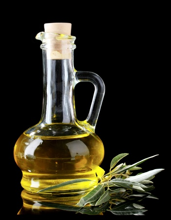 olive oil in jar on black background Stock Photo - 10068152