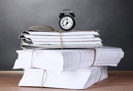 many folders and watch on gray background Stock Photo