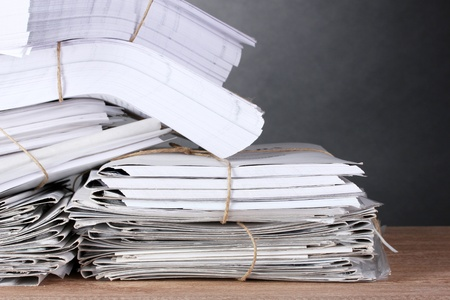 pile of documents: many folders and on gray background