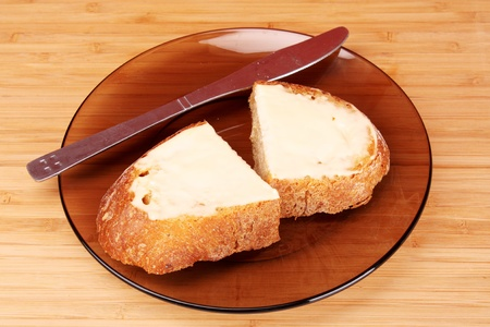 buttered: slices of buttered bread on a plate