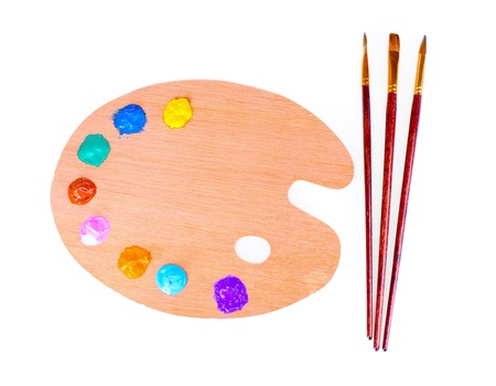 wooden art palette with blobs of paint and a brush on white background Stock Photo - 10164497