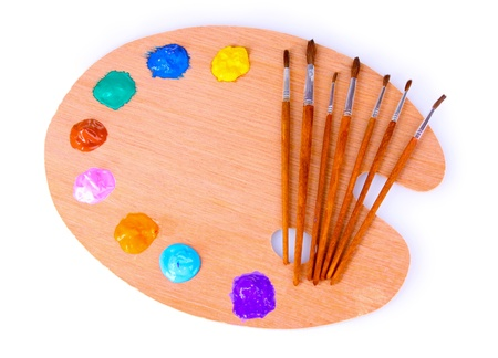 wooden art palette with blobs of paint and a brush on white background Stock Photo - 10164636